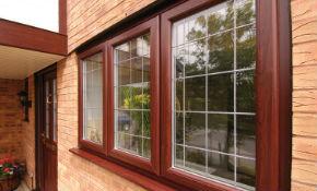 для загородной недвижимости идеально подходят коричневые пластиковые окна